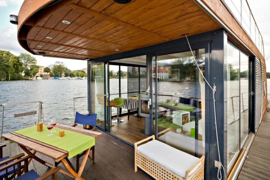 Nautilus Houseboats, floating homes, floating tiny home, tiny home designs, tiny house boats, floating structures, solar powered boats, tiny home living, boat life, boat design, solar powered homes, solar boats, boat homes, house boat design, nomad living