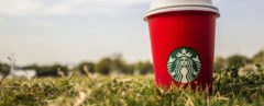 Starbucks, coffee, coffee cup, red coffee cup, red cup, grass, outside, nature