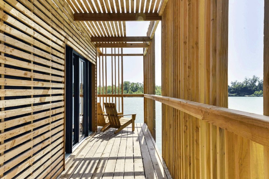 Bora Bora Wood Floating Cabin, Atelier Lavit, floating hotel, floating architecture, France, prefab, prefab cabin, green architecture, timber, natural light, skylights, natural wood