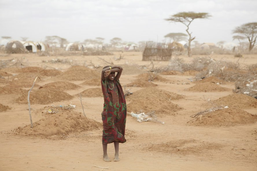 East Africa, drought, girl, graves, camp, malnutrition