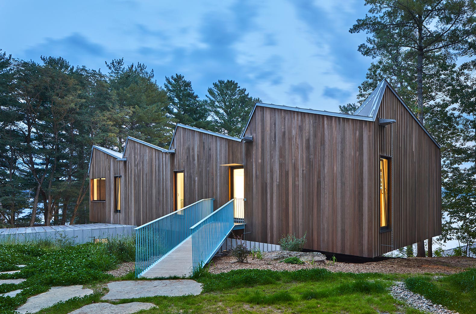 A Striking Sawtooth Roof Tops This Net Zero Lake House In Canada