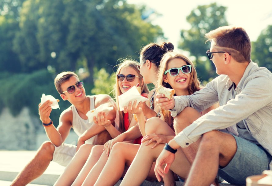 Teens, teenagers, friends, eating, city square, outside, sunglasses
