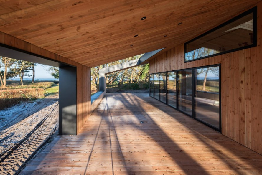 Treldehuset by CEBRA, Treldehuset in Vejle, Vejle contemporary architecture, Danish summer retreat, minimalist architecture in Denmark, minimalist summer getaway, larch and slate architecture,