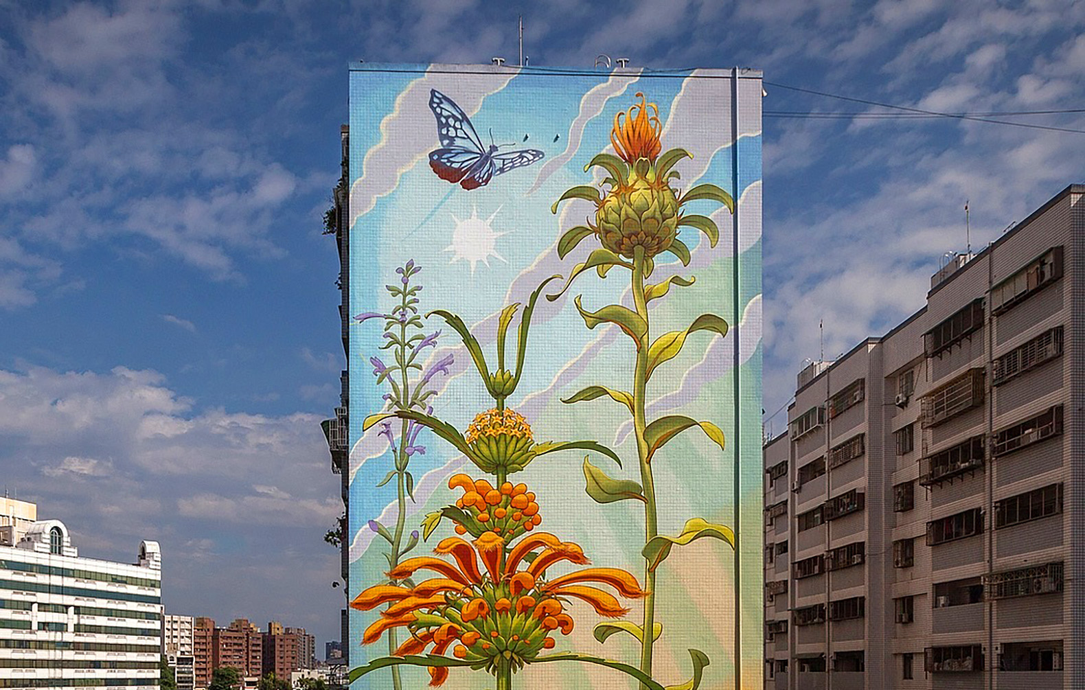 Gigantic murals of local flora sprout on buildings around the world