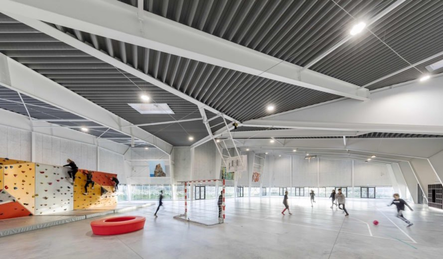 Ørestad City sports center by NORD Architects, Ørestad City sports facility, Ørestad City new architecture, green roofed sports center, timber clad architecture in Ørestad City, contemporary timber public architecture, Copenhagen sports center,