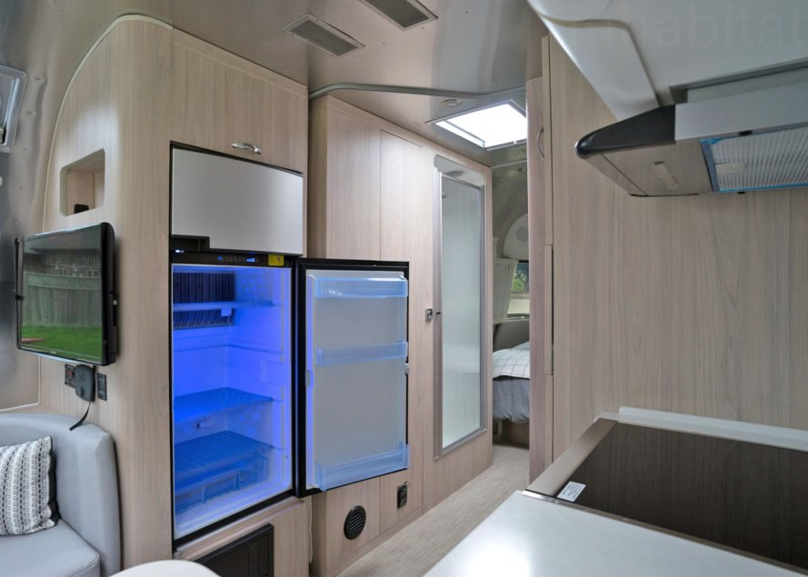 Airstream refrigerator, Airstream Globetrotter, camper, 2018 Airstream Globetrotter, airstream interior, small space living, tiny house, tiny home, mobile home, travel trailer, trailer home, trailer house