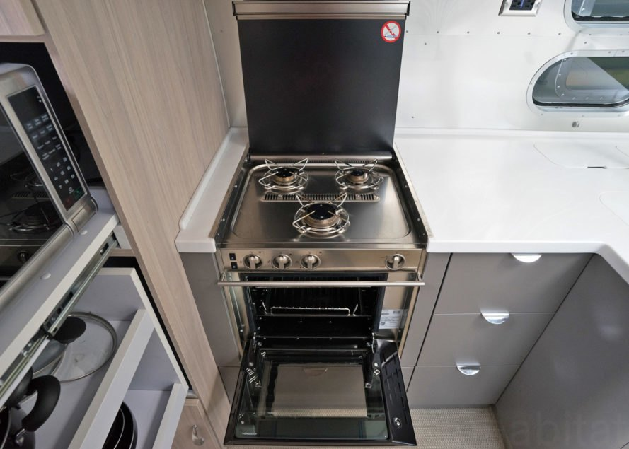 Airstream stove, Airstream oven, Airstream Globetrotter, camper, 2018 Airstream Globetrotter, airstream interior, small space living, tiny house, tiny home, mobile home, travel trailer, trailer home, trailer house