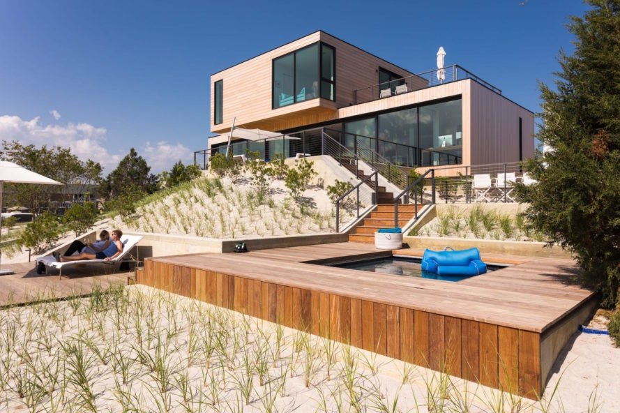 Stormwaters Sweep Beneath This Coastal Beach House Raised