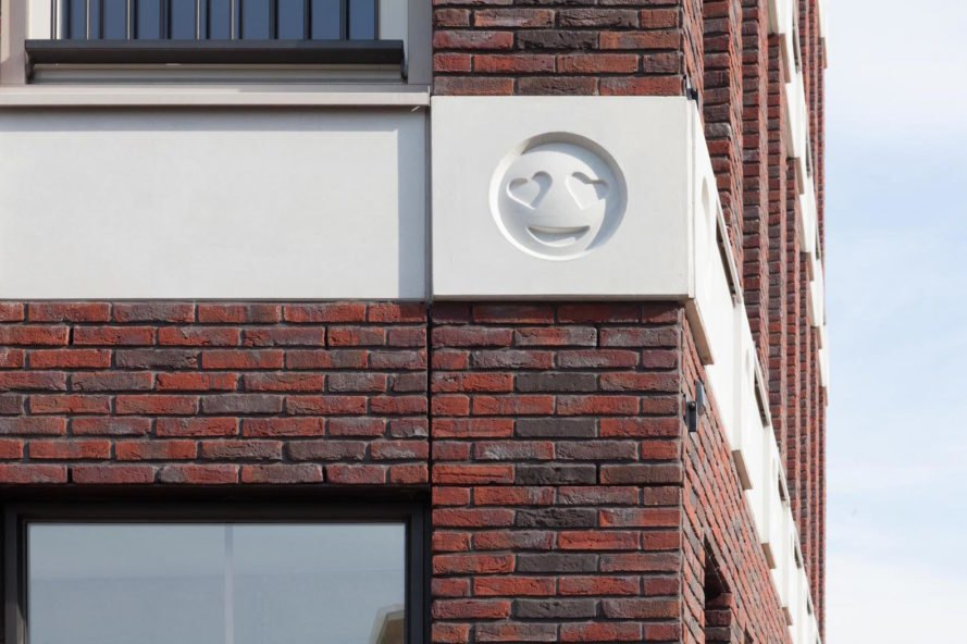 Emoji Architecture by Attika Architekten, emoji gargoyles, emoji in architecture, Emoji Dutch building, Emoji Vathrost architecture, Emoji cast in concrete, Emoji architecture decoration