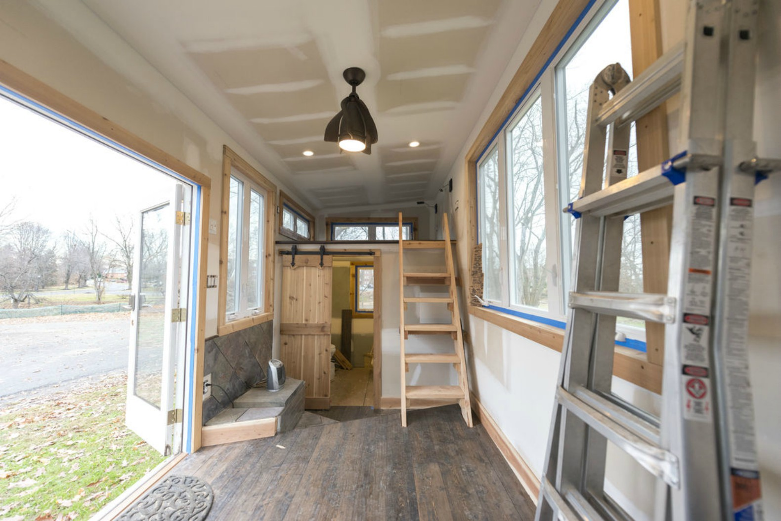 DIY mobile tiny cabin is made out of old skateboards and a