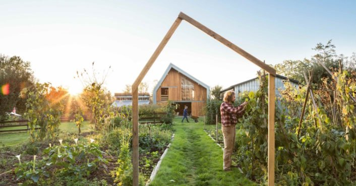 photo image Traditional barn raising techniques bring a modern cost-effective farm to life