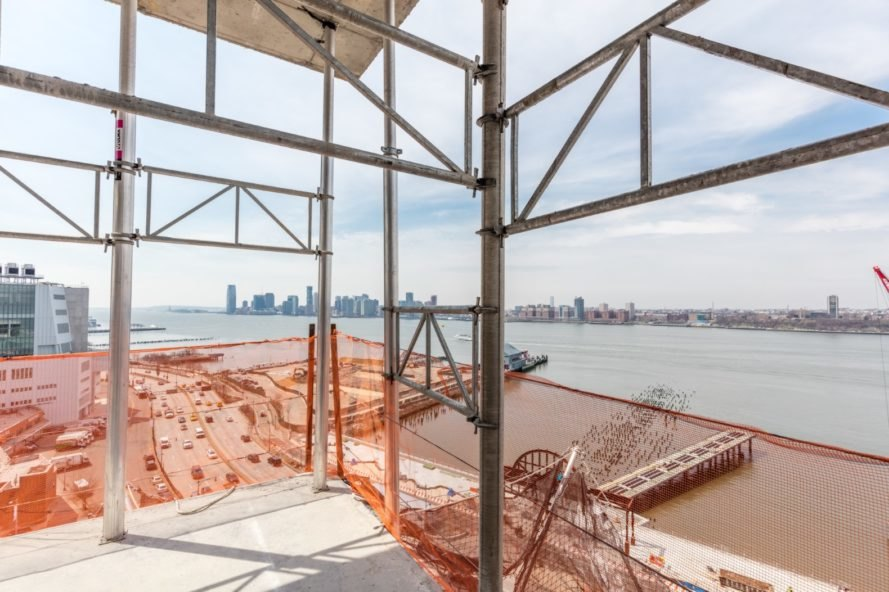 The Hudson River can be glimpsed from 40 Tenth Avenue, designed by Studio Gang, in New York City