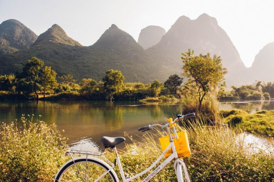 A mountain, lake, and bicycle in the city of Guilin in southern China