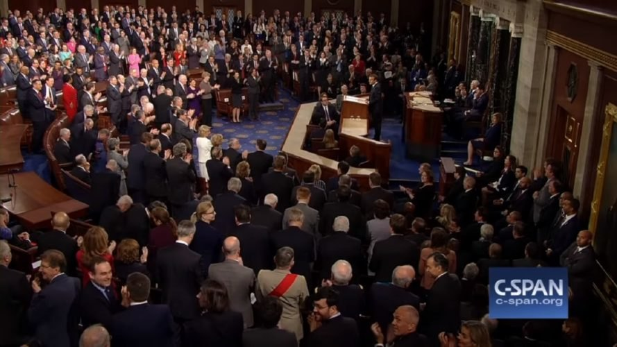 The United States Congress applauds a speech by French President Emmanuel Macron