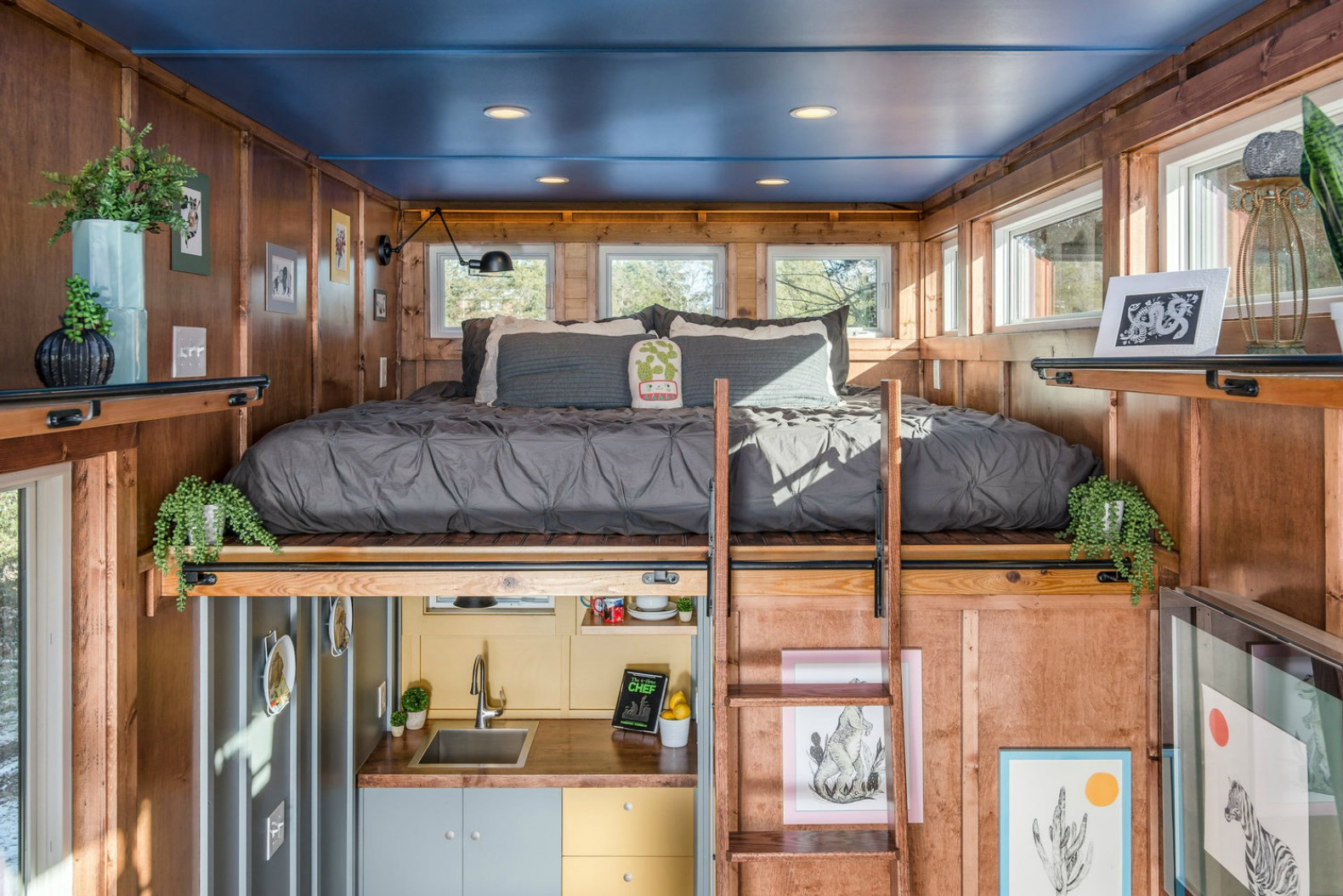 new frontier 39 s cornelia tiny home is a writer 39 s studio made with reclaimed wood inhabitat. Black Bedroom Furniture Sets. Home Design Ideas