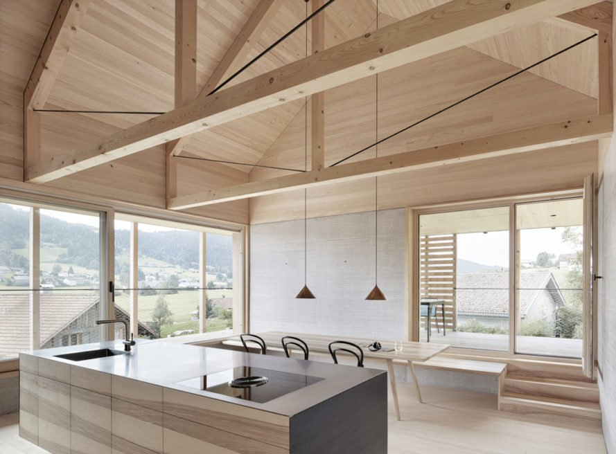 Minimalist timber home gracefully blends into the Austrian landscape