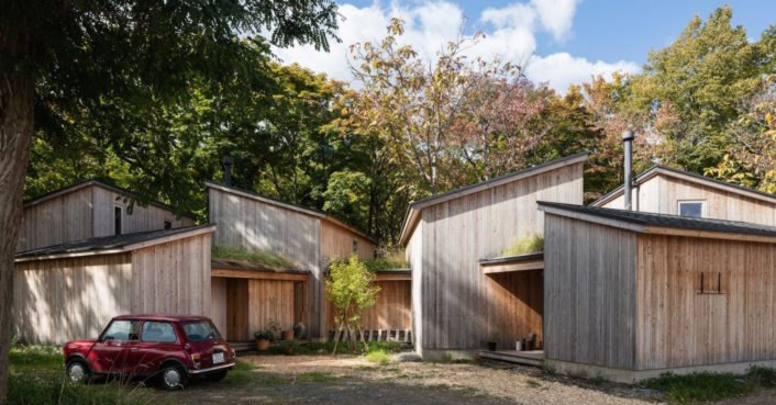 This dreamy cluster of cabins houses light-filled live/work spaces in Hokkaido