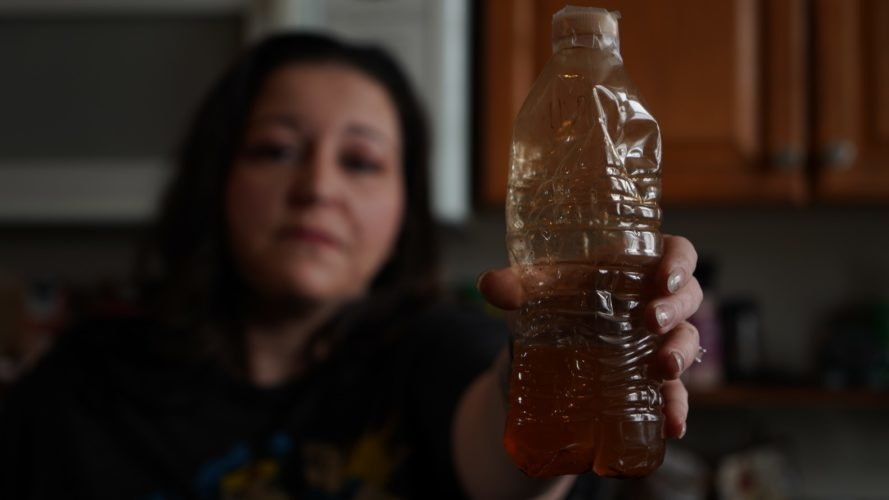 2018 Goldman Environmental Prize winner LeeAnne Walters hold a bottle of polluted water