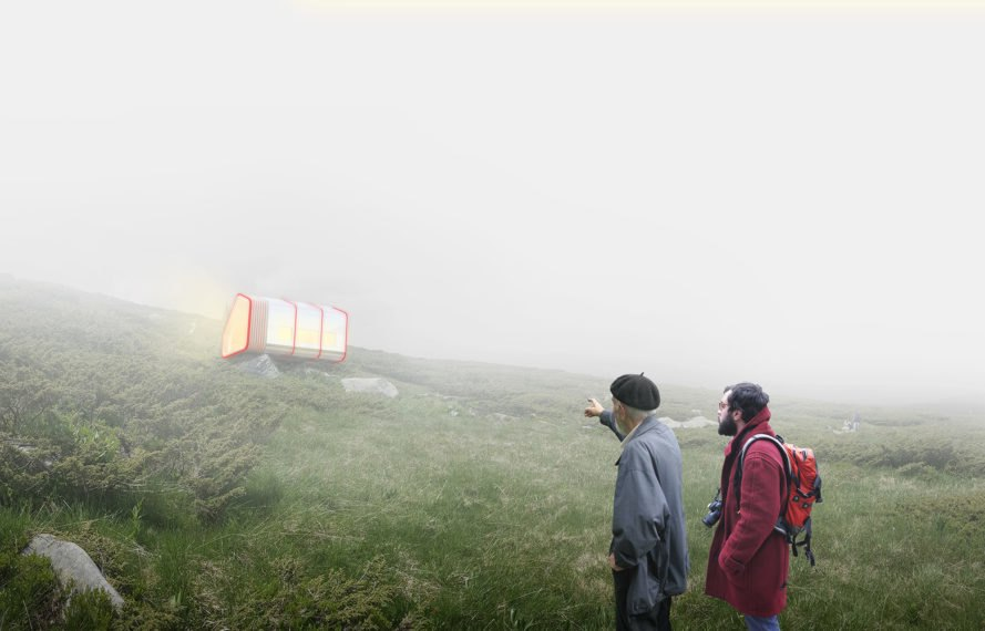 Hikers walk past the net zero shelter