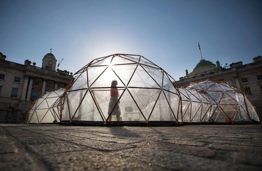 Visitor walking inside Pollution Pods by Michael Pinsky