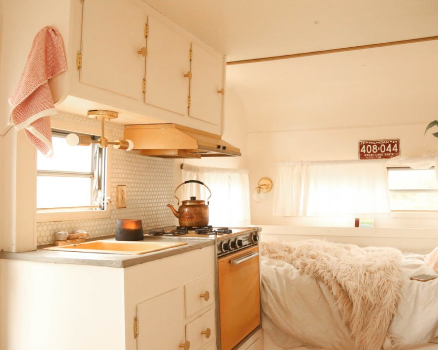 Probably This, restored camper, 1969 camper restoration, renovated 1969 Globestar, vacation home on wheels, peel-and-stick tile flooring, tiny home on wheels, camper life, tiny home design, camper renovation, diy camper renovation, diy tiny living, decorating a camper, interior design,