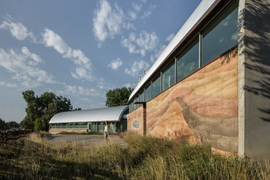 rammed earth exterior walls Swoon Art House by tres birds workshop