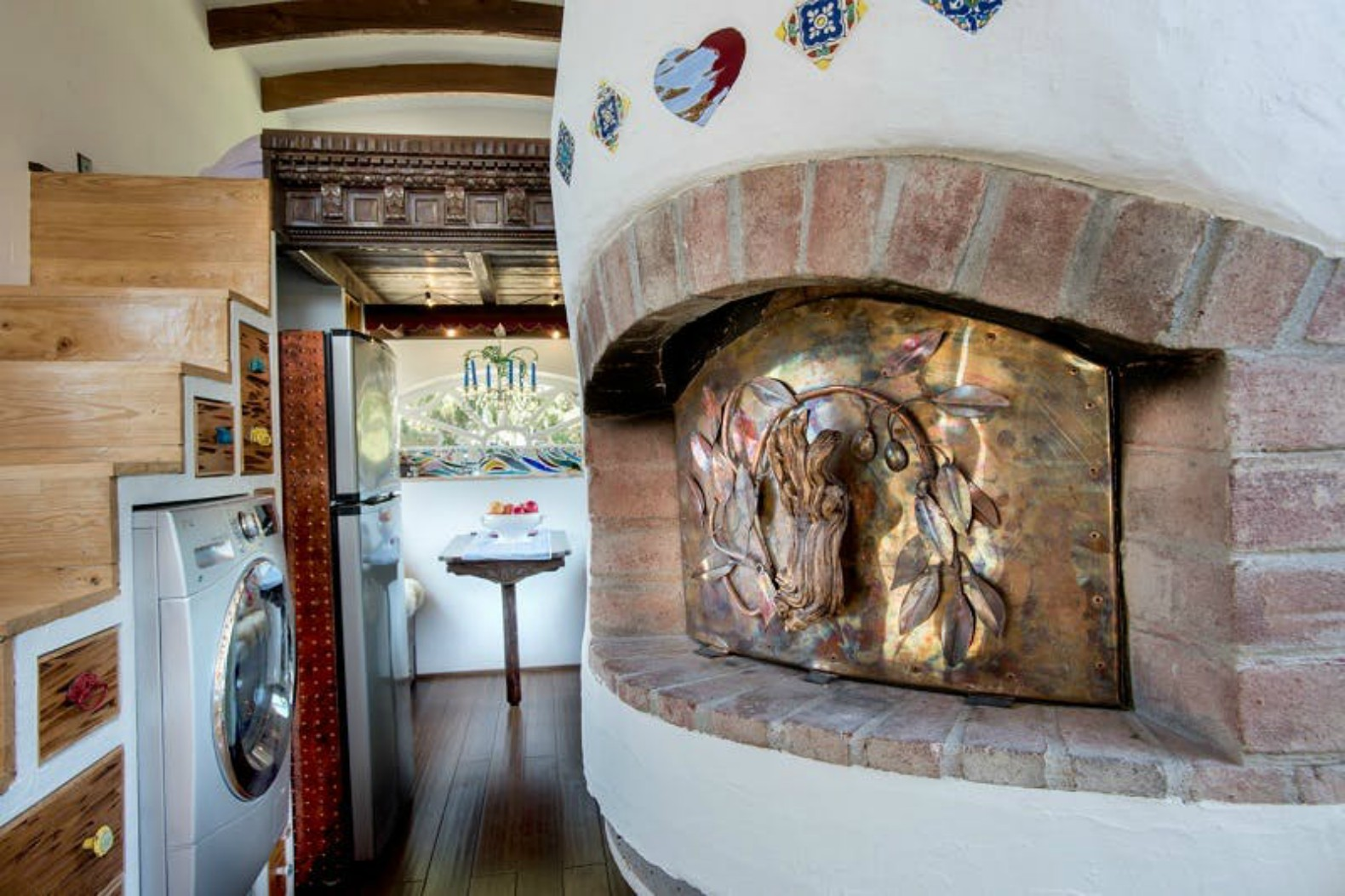 This whimsical tiny house with its own pizza oven was built for just on arch windows, arch tiny cabins, arch design,