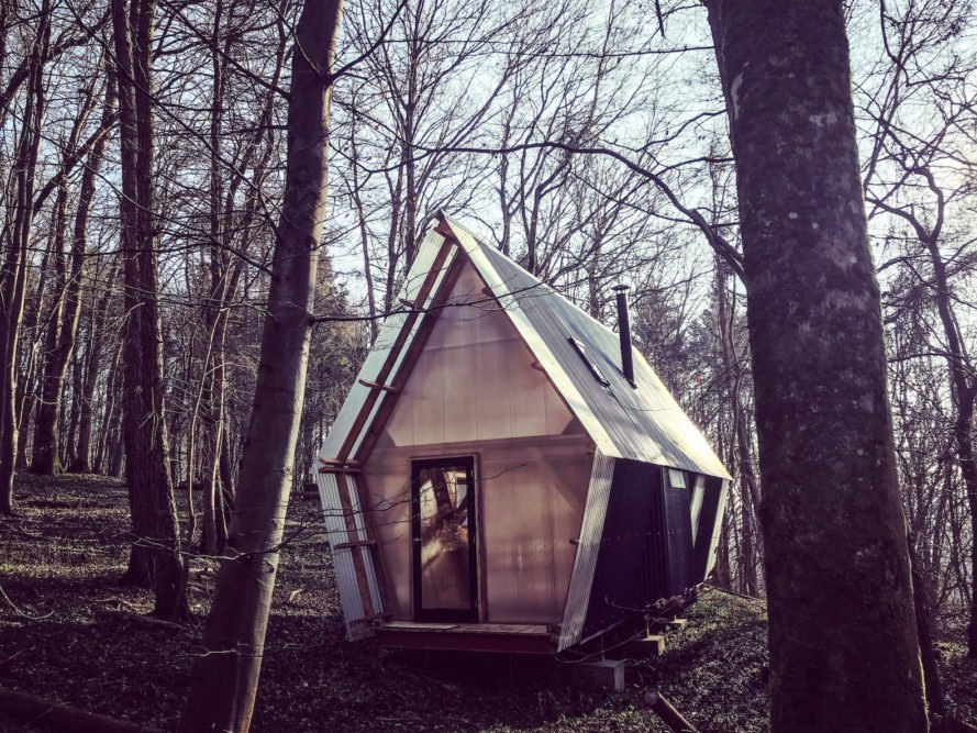 Trailer by Invisible Studio, Invisible Studio same section milling, low cost timber cabin, low cost self build project, plywood interior and polycarbonate cladding, reclaimed materials in self build project, Invisible Studio design build