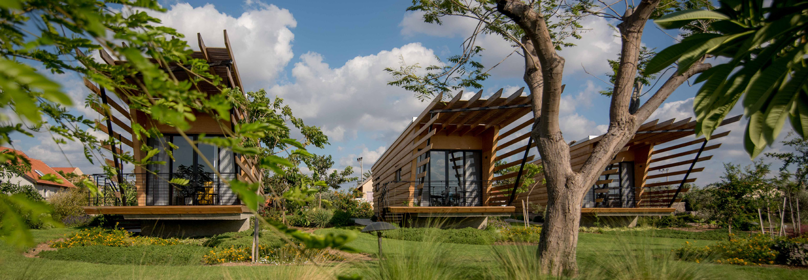 These timber tiny houses use bold pergolas to shade against the glaring sun in Israel