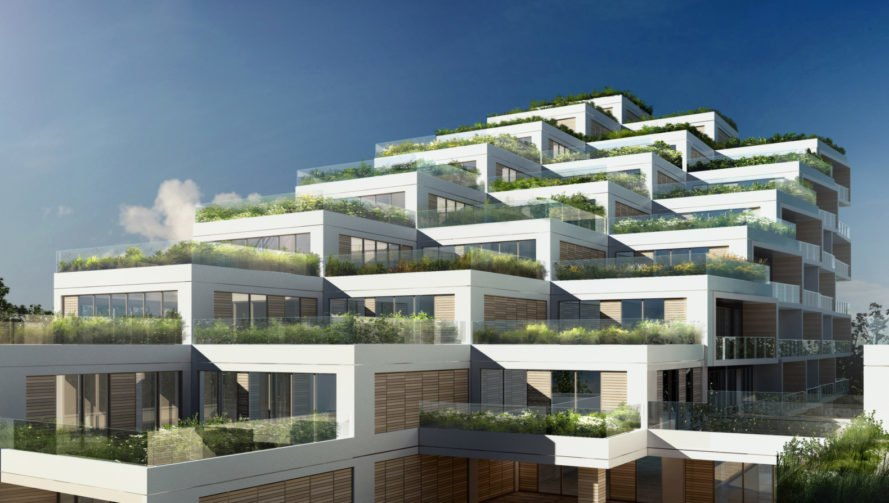 multiple tiers of green roofed apartments