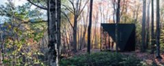 A triangular tiny house in the woods