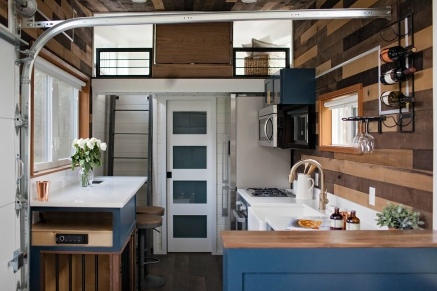 kitchen and sleeping loft in Breezeway Tiny Home