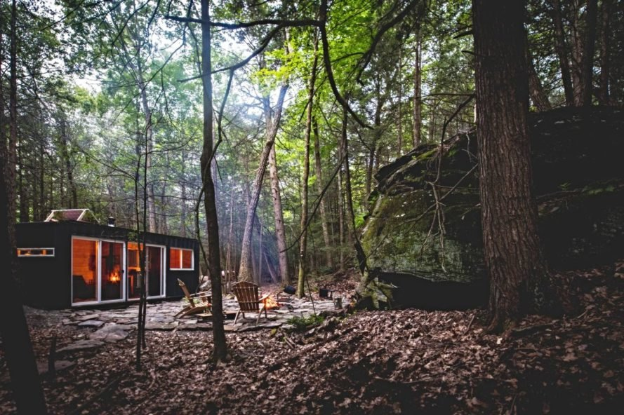 a cabin surrounded by trees