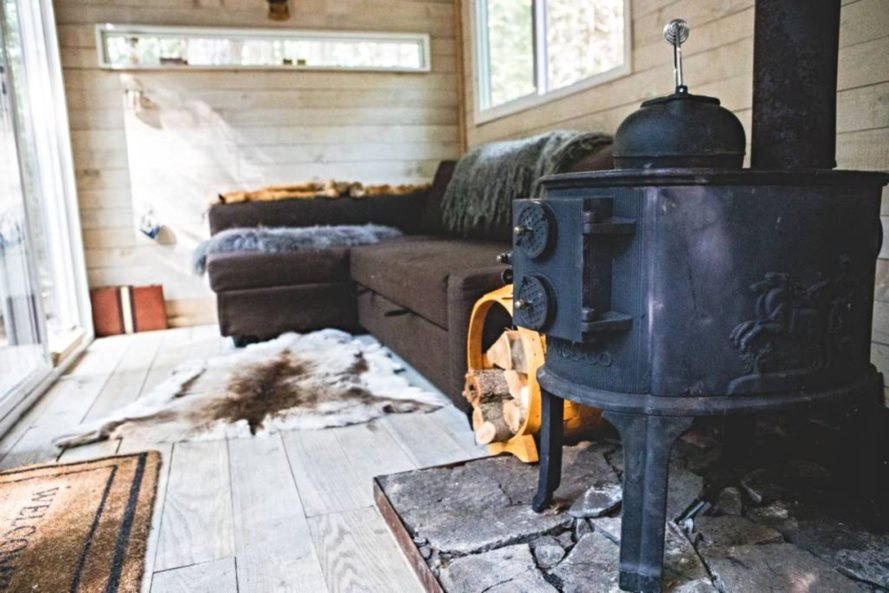 a wood burning stove and sofabed
