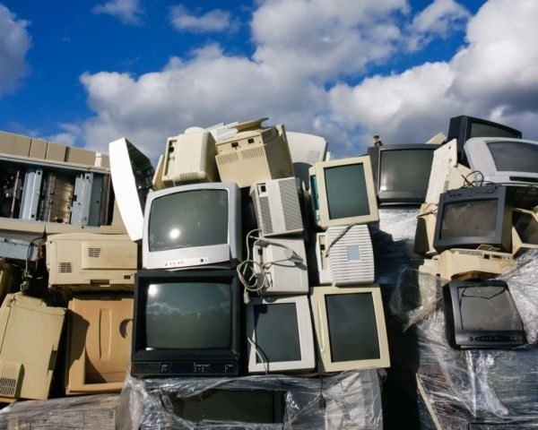 A pile of old TV and computer monitors