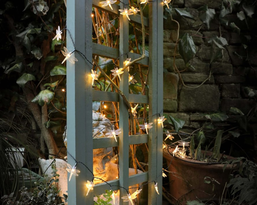firefly lights wrapped around a trellis