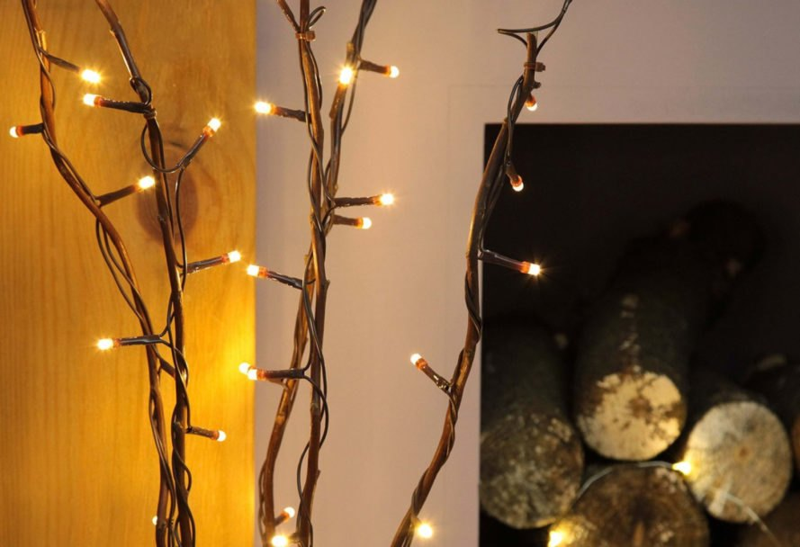 tiny lights wrapped around tree branches