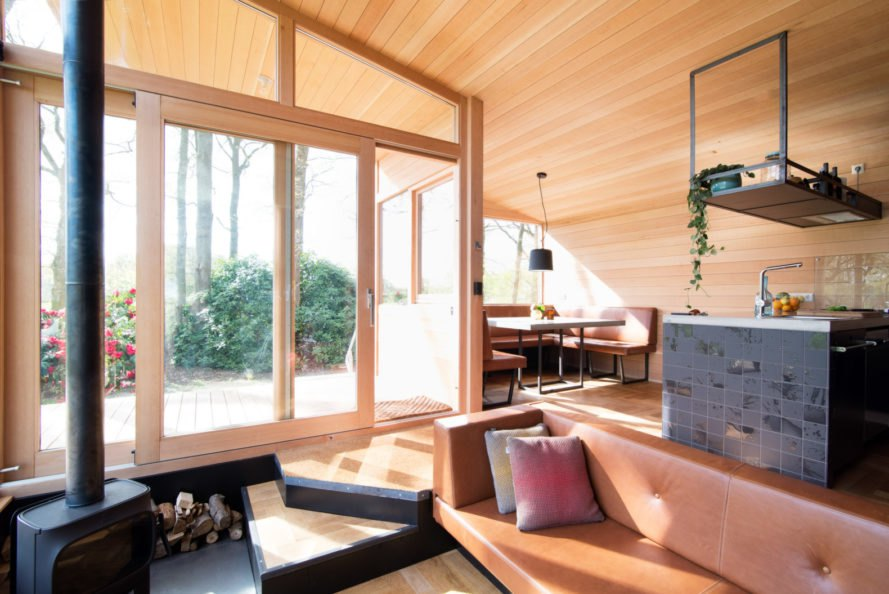 large windows let in natural light to a wooden interior