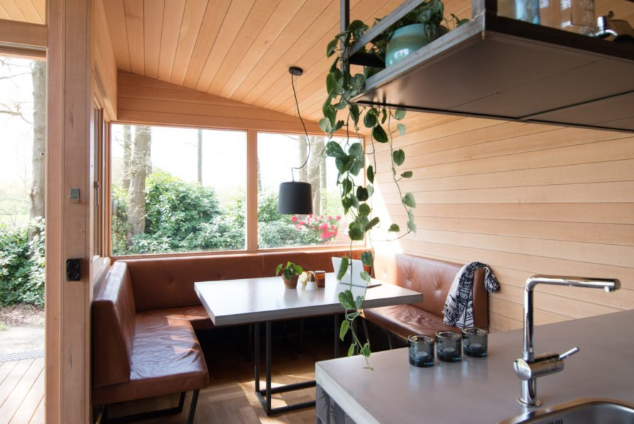 dining nook with large window and wooden walls