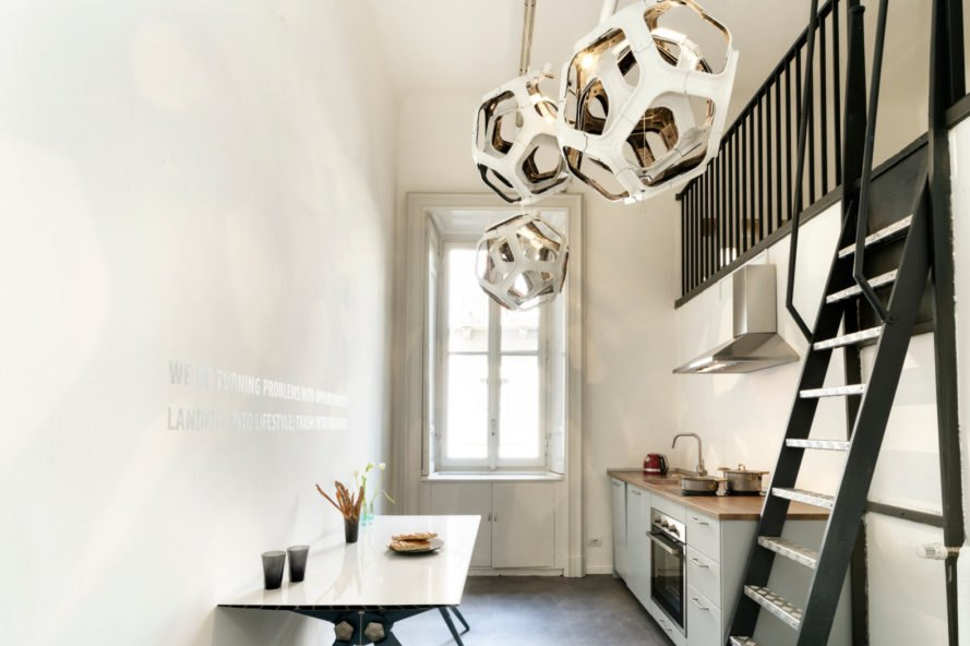 a kitchen space with bulb-like lights