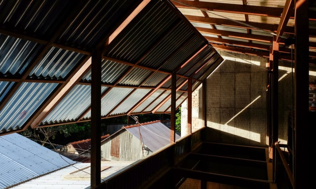 The windows and walls are made from thin corrugated metal panels that swing open to let optimal amounts of natural sunlight and ventilation into the home   inhabitant.com