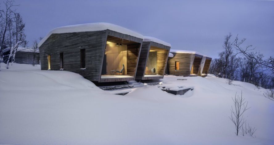 series of cabins covered in snow