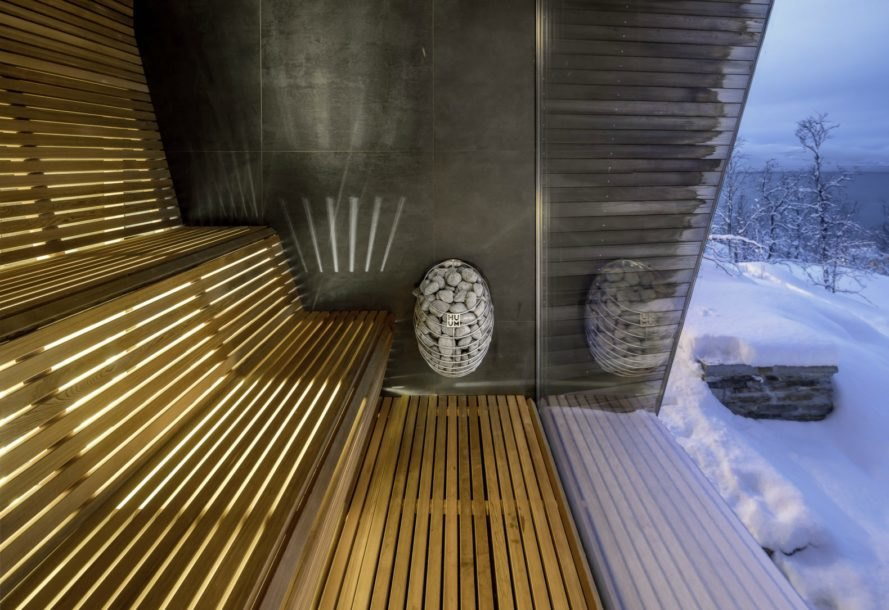 wooden sauna with glazed wall