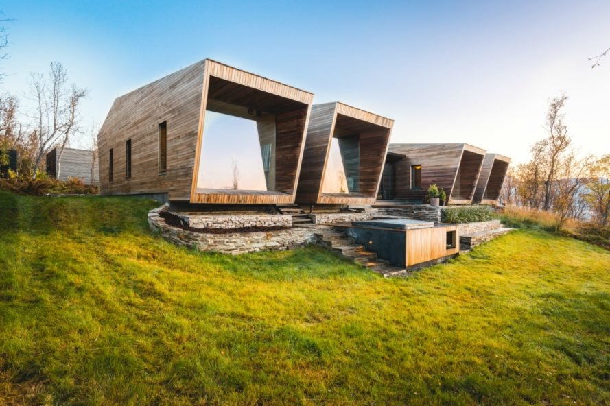 A cluster of wooden cabins create a serene weekend retreat in Norway
