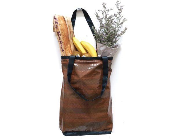 Tote bag filled with produce and flowers