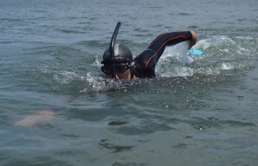 Professional long distance swimmer Ben Lecomte swimming in the waves