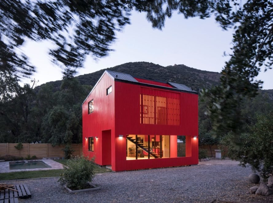 large red home surrounded by trees