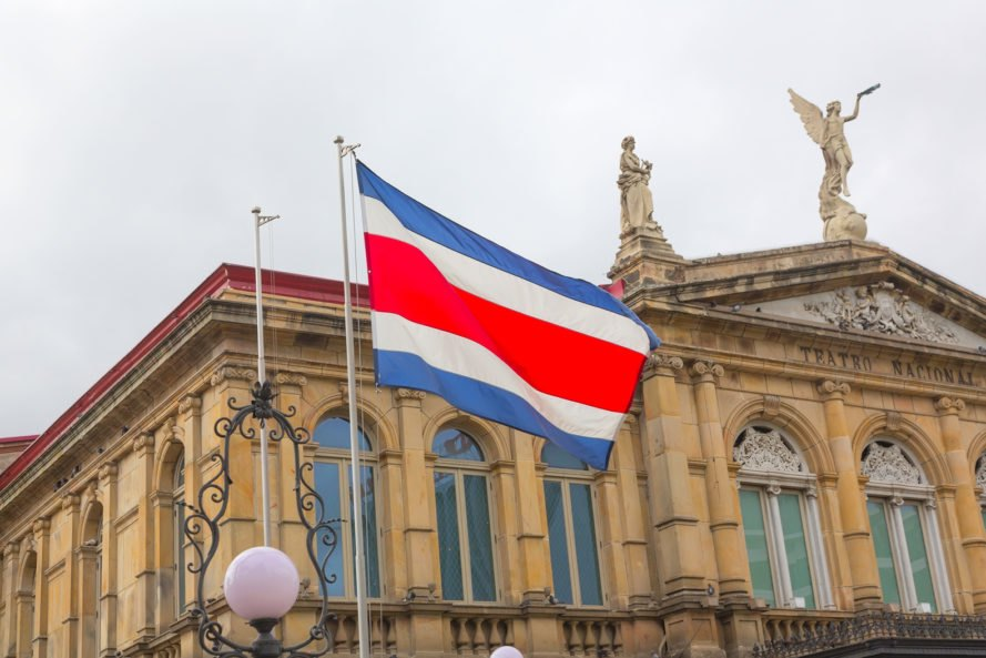 Flag of Costa Rica in front of the San Jose National Theater