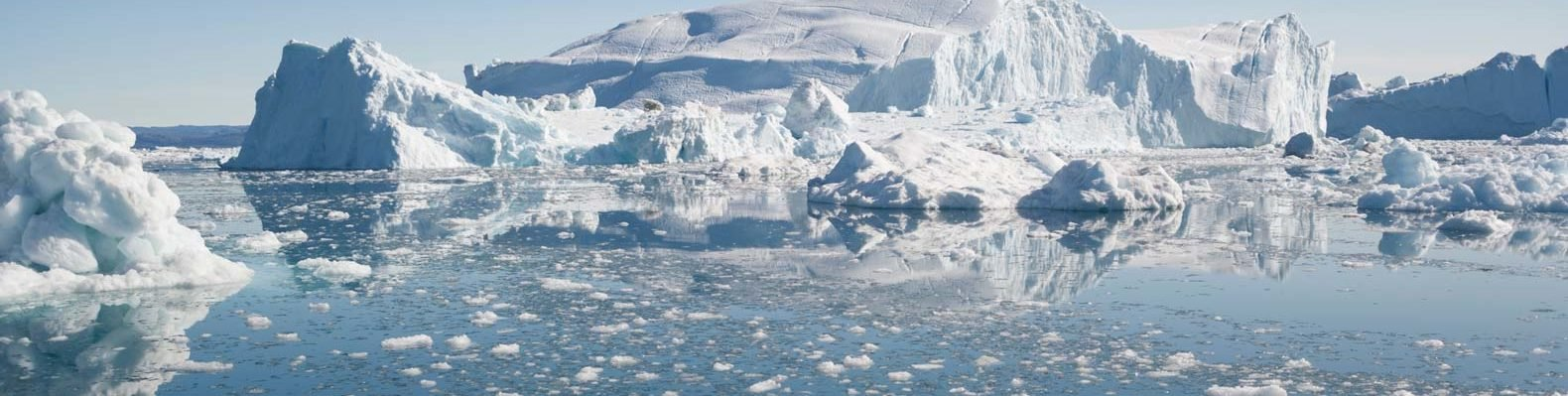 An iceberg and ice floes in the Arctic sea