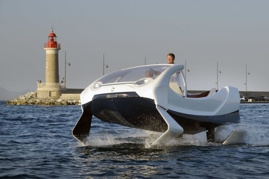 The original SeaBubble in St. Tropez with a lighthouse in the background